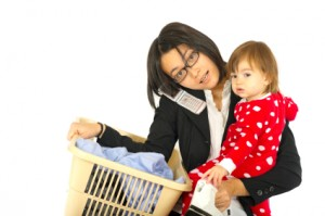 Woman Mutitasking with Baby, Laundry, Phone and Iron