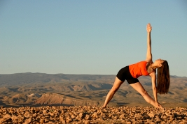 A woman doing yoga for relaxation--triangle pose