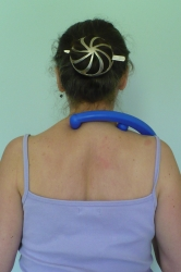 The Body Back Buddy: pressure points on upper shoulders