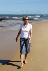 Woman Taking Walk on Beach