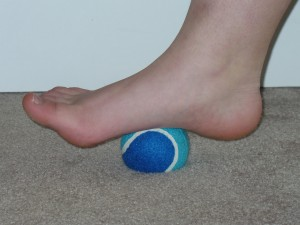 Rolling a tennis ball for a foot massage