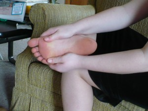 Spreading your foot during a foot massage