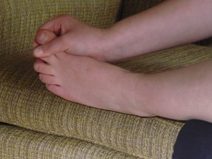 Pulling the big toe during a foot massage
