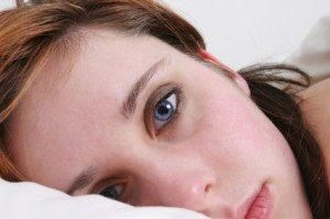 Woman needing sleep and stress relief