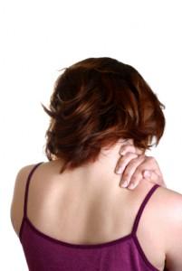 A woman giving herself a massage