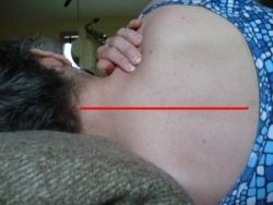 Gving yourself a shoulder massage lying down