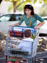 Stressed mom pushing a grocery cart