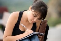 Young woman journaling for stress relief